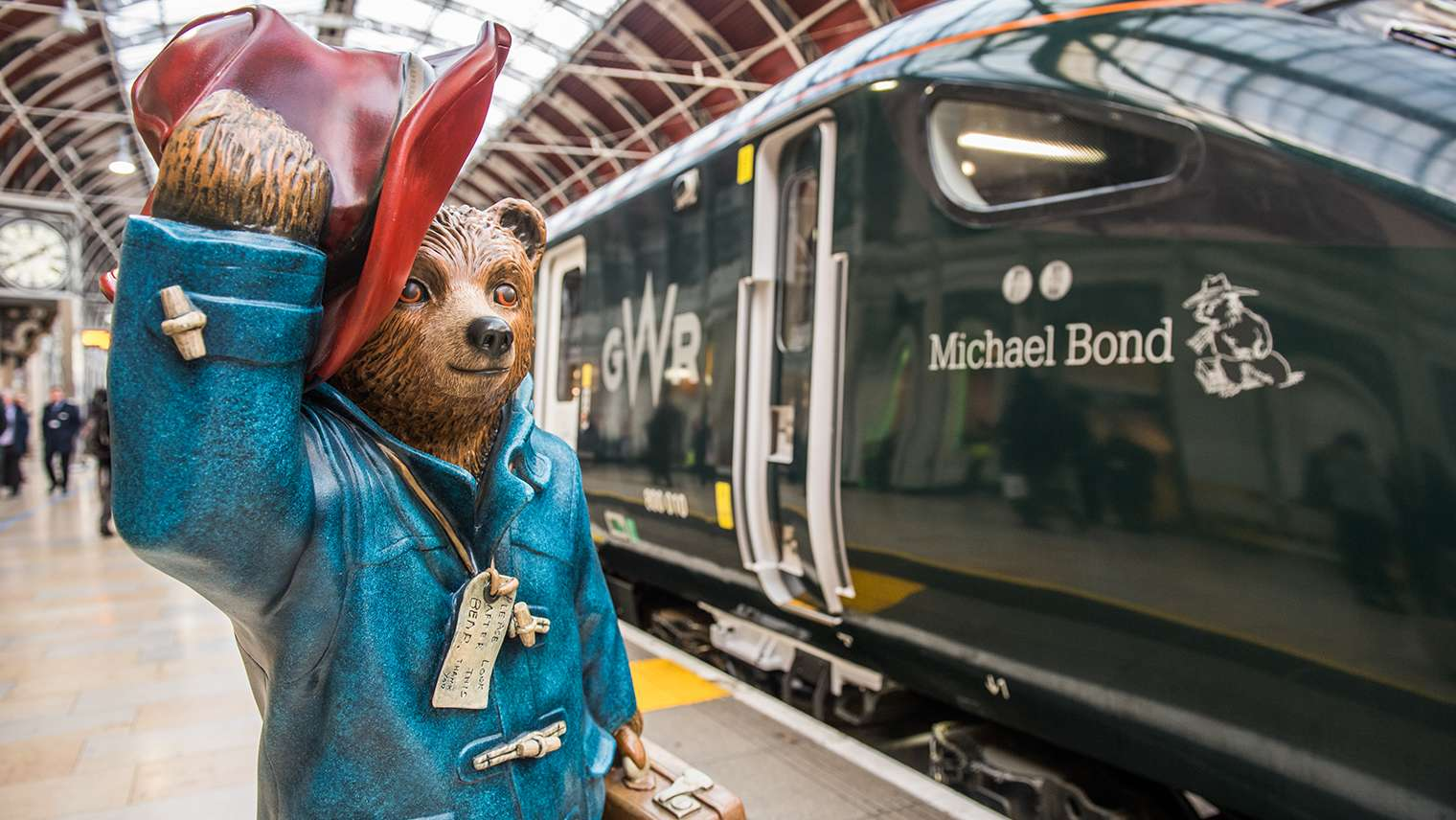 Paddington Bear statue next to a GWR Intercity Express Train named after Michael Bond