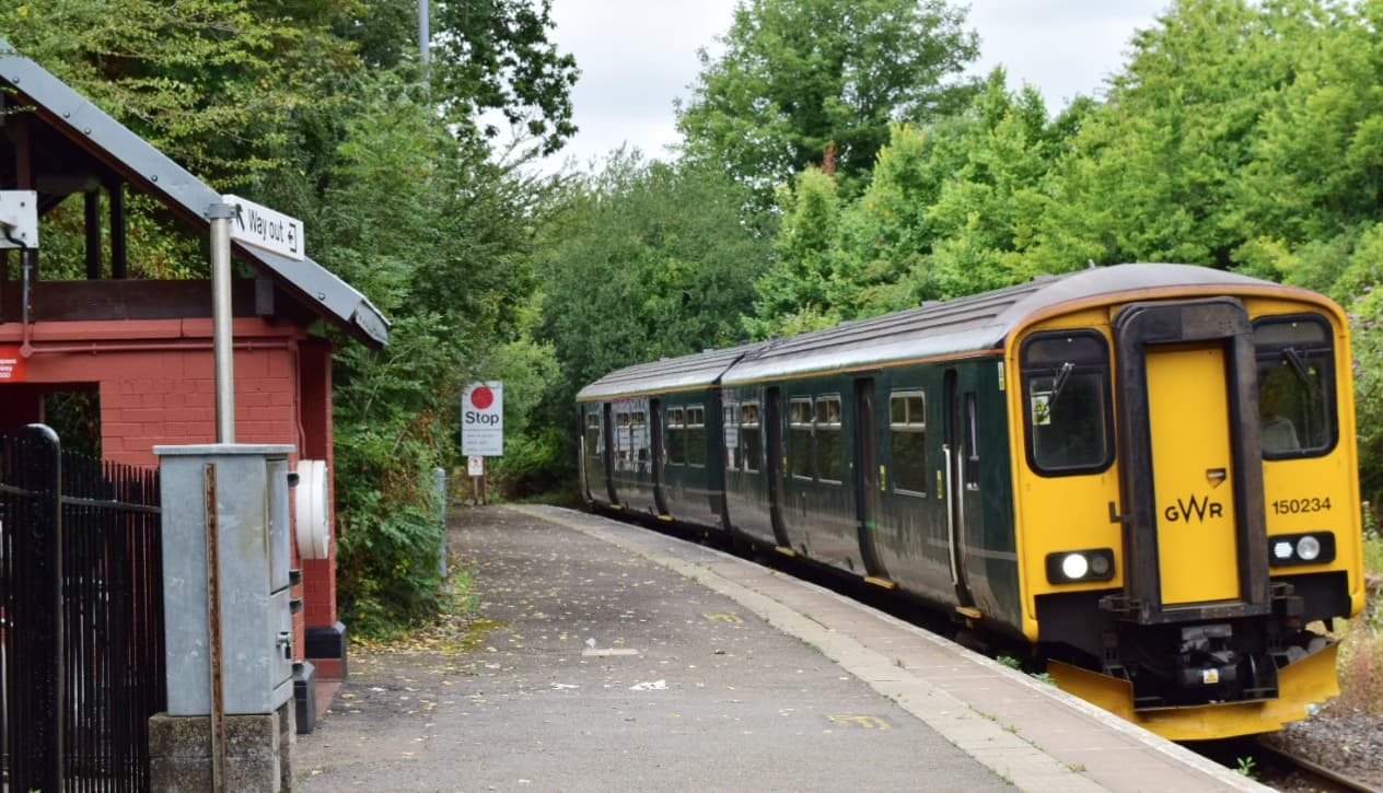A train sat at a station on a branch line.