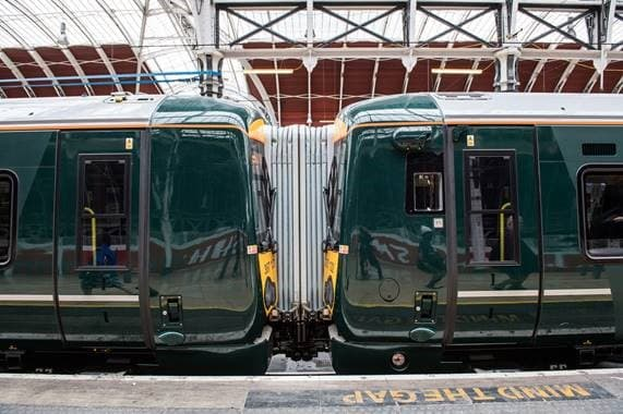 Image of two clean shiny GWR carriages coupled together