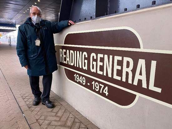 GWR staff member Pat Kemp in front of Reading General sign