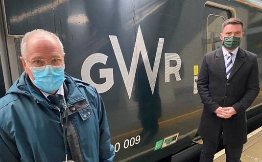 GWR staff member Pat Kemp in front of train with station manager