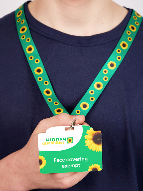 Person wearing the sunflower lanyard.